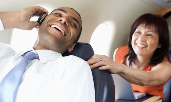 Multi-ethnic businesspeople on airplane