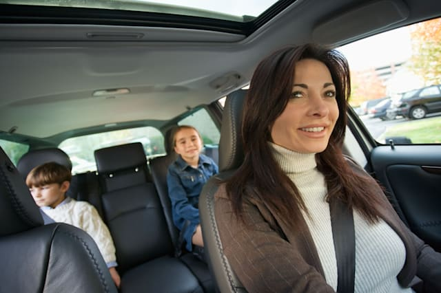 Mother driving with children in backseat