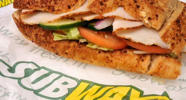 Subway turkey submarine sandwich on wrapper with subway logo USA.