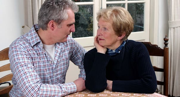 Adult woman talking to grown up son