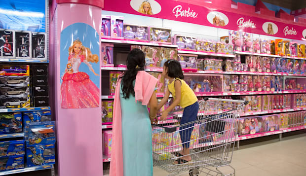Customers looking at Barbie accessories in a supermarket in India