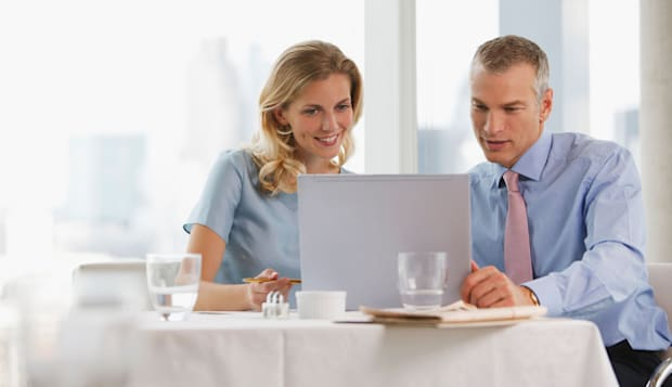 Business people having working lunch in restaurant