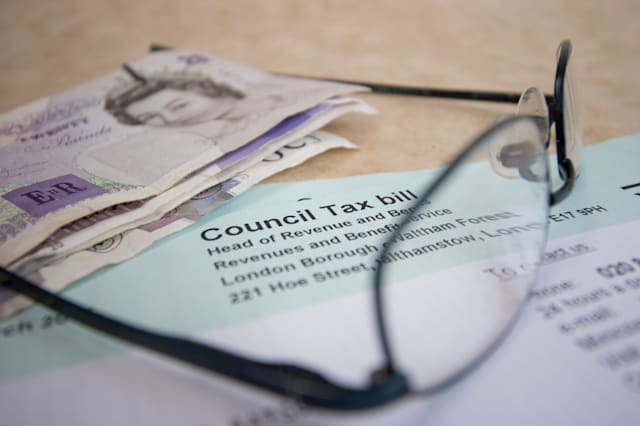 UK council tax bill with eyeglasses and cash
