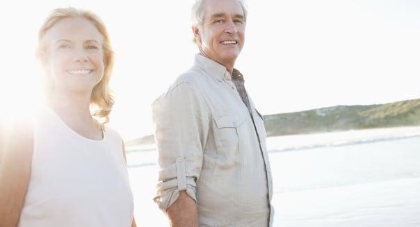 Happy couple smiling on beach