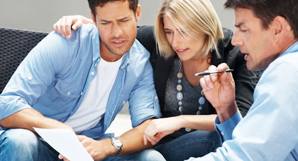 C52925 Portrait of a financial advisor explaining investment plans to young couple  couple; meeting; thinking; planning; insuran