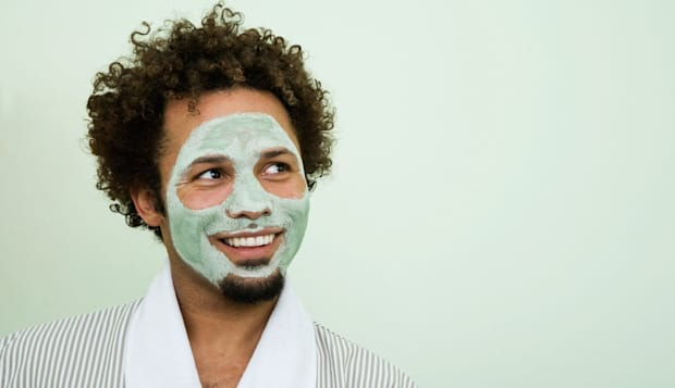 USA, California, Oakland, portrait of smiling man with facial mask
