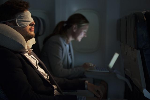Businessman sleeping on airplane