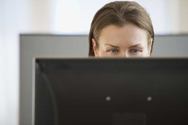 Eyes looking at computer monitor in officePeople, Business, Technology, Horizontal, Indoors, Office, 30-34 Years, Front View, C