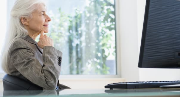 Senior businesswoman looking away in thought