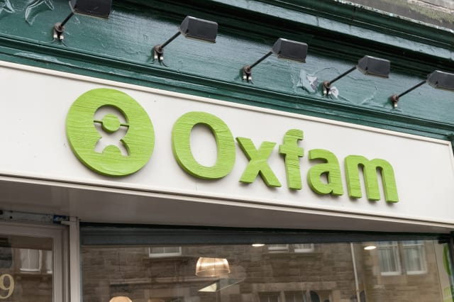 Oxfam window sign causes sexism row