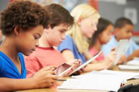 pupils in class using digital...