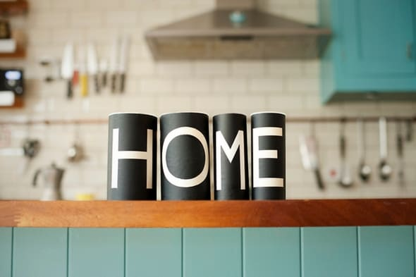 Word 'Home' on kitchen counter