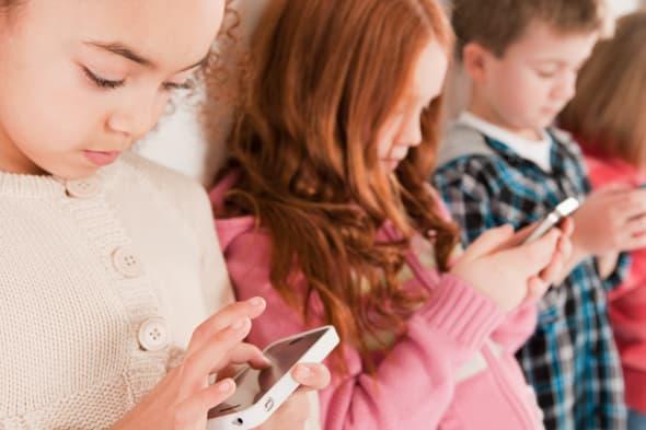 Children looking at smartphones