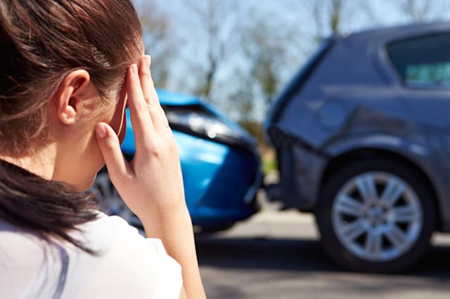 young woman,worried,road accident,car accident