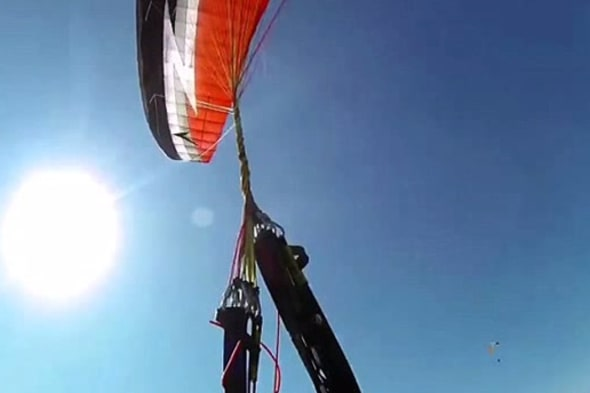 Paraglider gets wires twisted mid-flight and crashes into rock face
