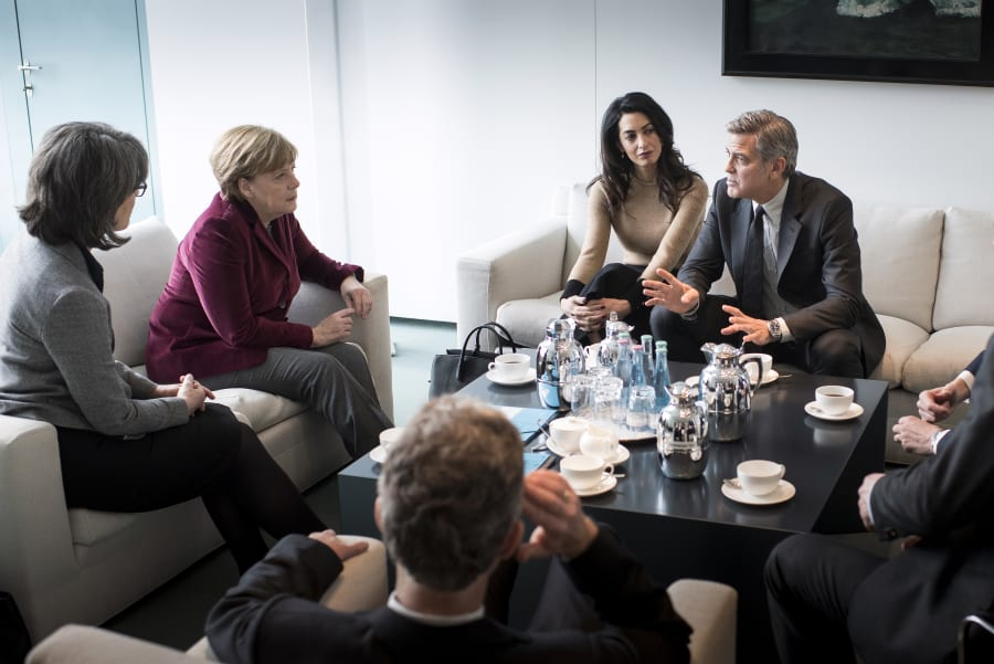 German Chancellor Angela Merkel meets with George Clooney and Amal Clooney at the Federal Chancellery...