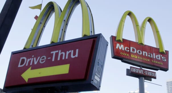 McDonalds Sales (FILE - In this Dec. 20, 2010 file photo, McDonald's signs sprout from the restaurant's parking lot in New York.