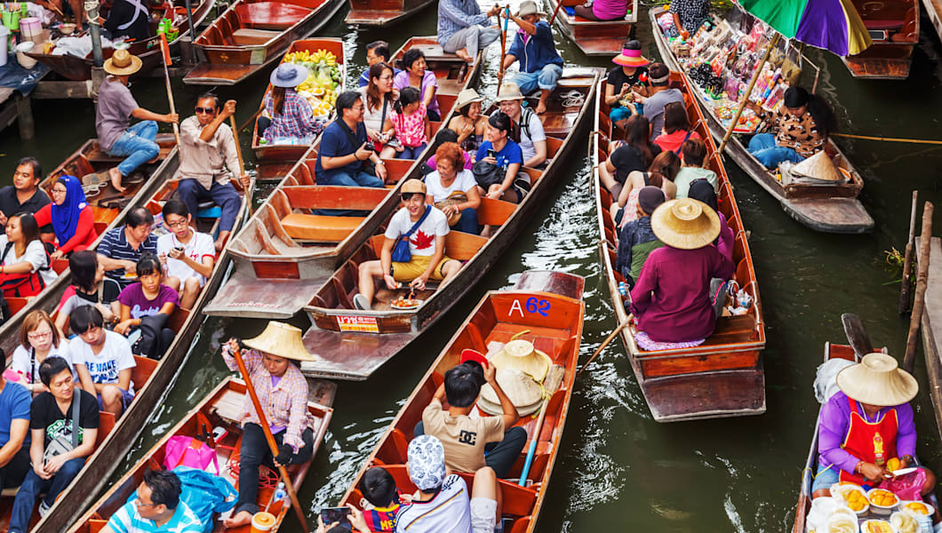 tourists at Damnoen Saduak in Thailand