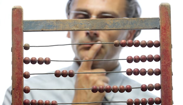 pensive accountant with an old abacus