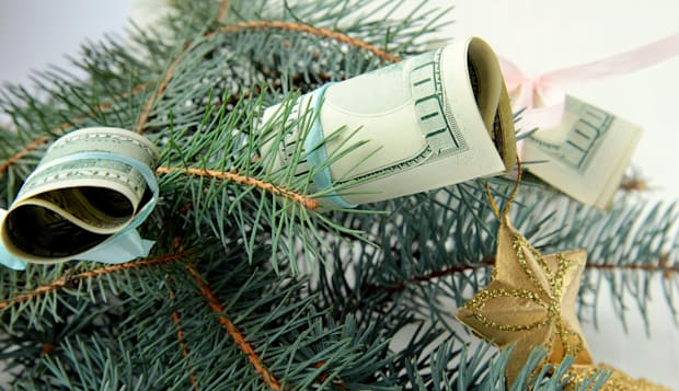 American dollars on the Christmas tree as decoration
