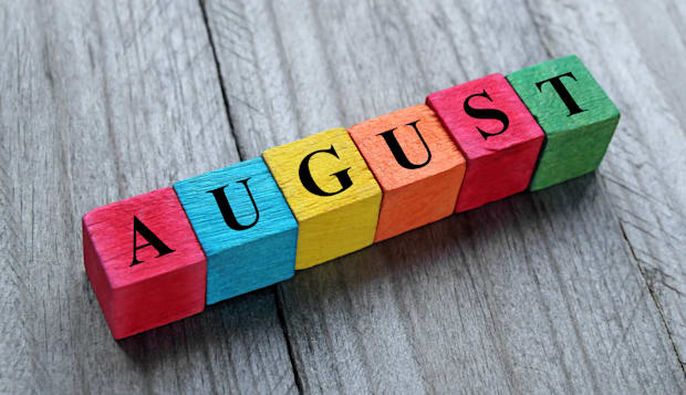 word august on colorful wooden...
