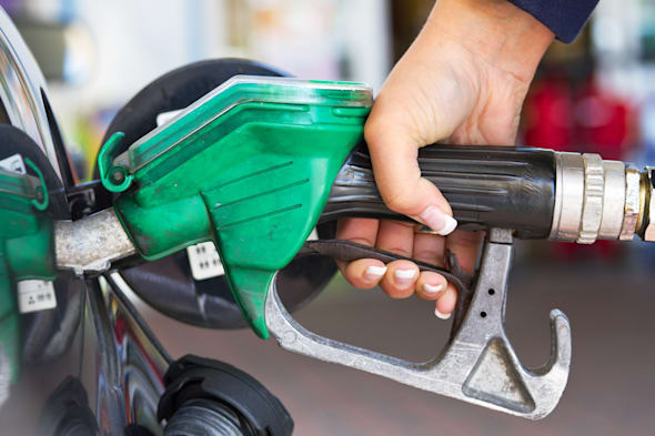 Female hand refilling the car with fuel