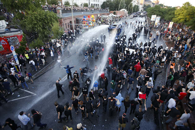German riot police use water cannons against protesters during the demonstrations during the G20 summit...