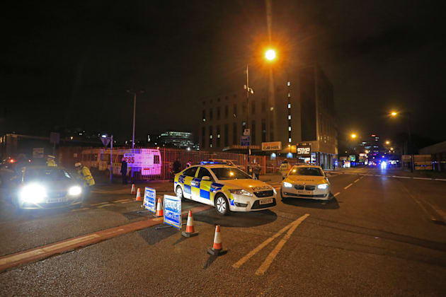 Police close off the roads leading to the Manchester Arena stadium. With the Arena car park closed and...