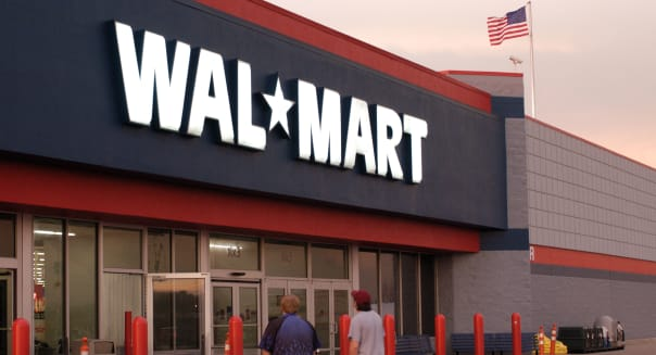Exterior of Wal-Mart store with two customers walking in