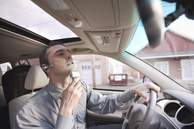 Businessman Shaving While Driving