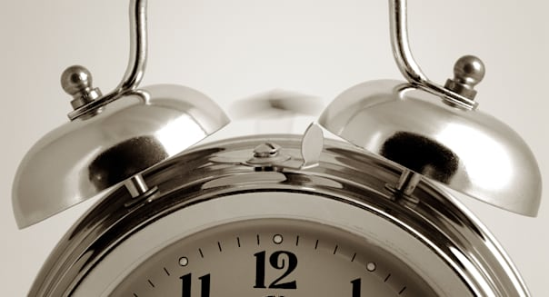 Abstract of an Analogue Alarm Clock Ringing its Bells Early in the Morning