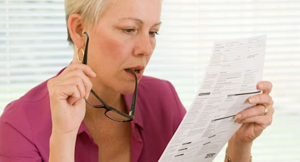 woman reading credit card / bank statement