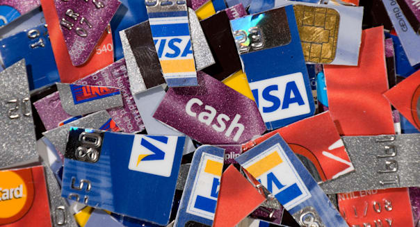 Pile of cut up assorted bank credit cards