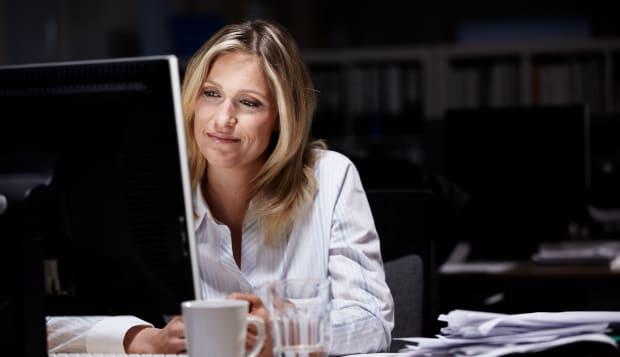 Businesswoman working in dark office