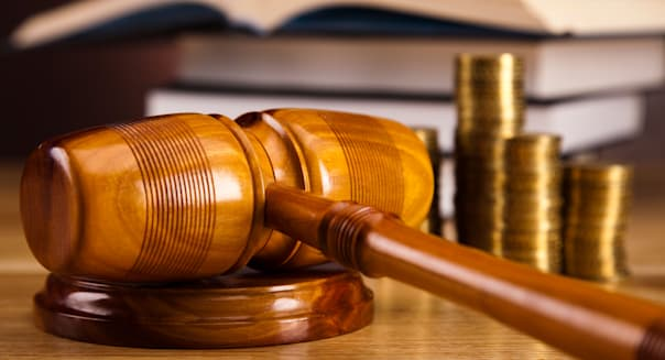 Wooden gavel barrister,scale of justice and golden coins