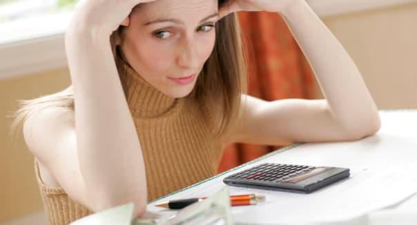 Worried woman looking at bills