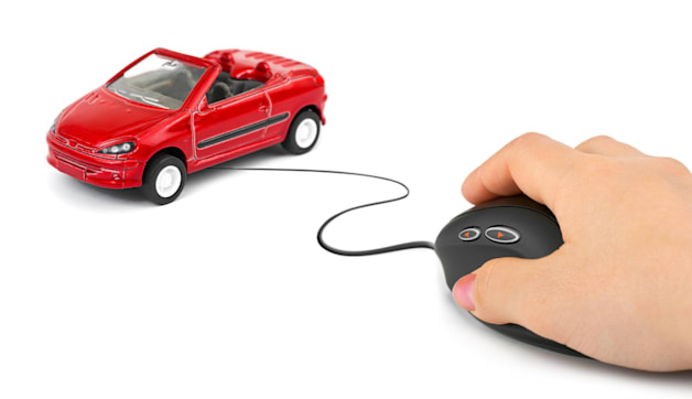 Hand with computer mouse and car