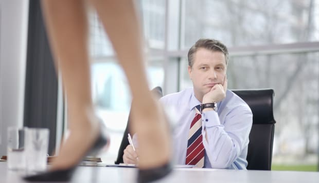 Businessman looking at businesswoman on table
