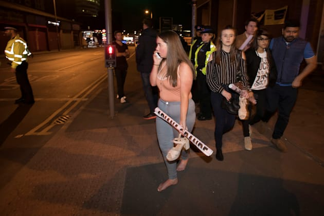 Concert-goers flee the stadium. Many try to make contact with family members or friends gone missing...