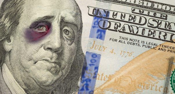 Bruised, Battered and Black Eyed Ben Franklin on the Newly Designed United States One Hundred Dollar Bill.