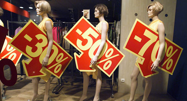 clothing-store dummies with rebate price tags