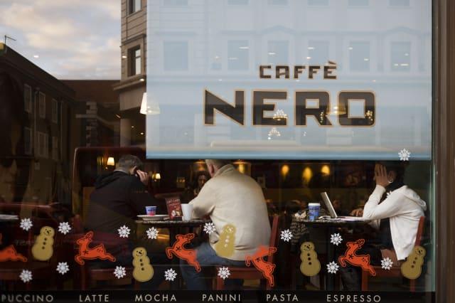 UK - London - Coffee drinkers in Caffe Nero window