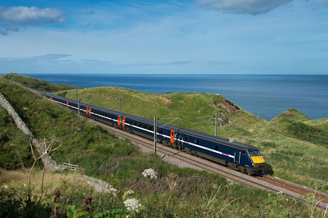High speed East Coast Trains train on the East Coast Main Line running alongside the coast in the North of England.