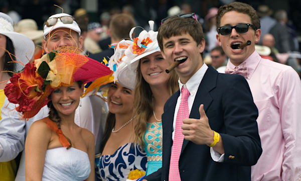 Group of Young Women and Men Having Fun in the Grandstand at the 2011 Kentucky Derby in Louisville, Kentucky