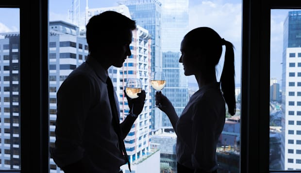 man and woman having glass of...