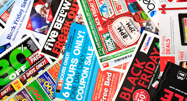Sale papers advertising deals on Black Friday (day after Thanksgiving) in USA