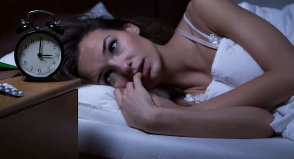 woman lying in bed sleepless at ...