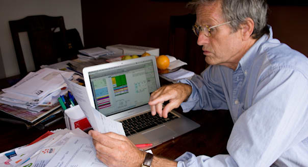 middle aged man looking stressed over finances