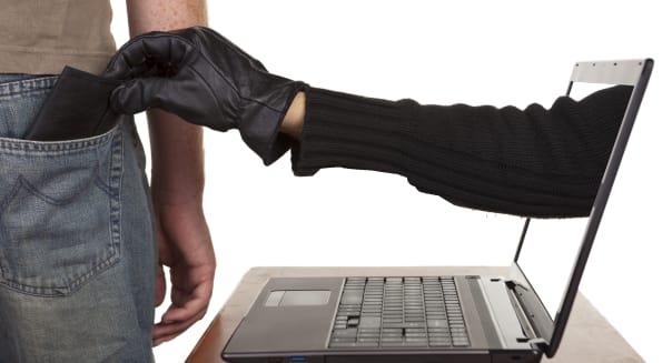 internet theft   a gloved hand...