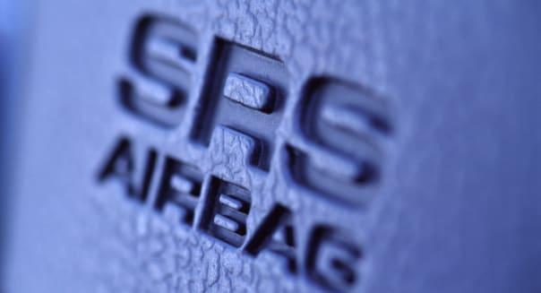 SRS AIRBAG motif on a car steering wheel